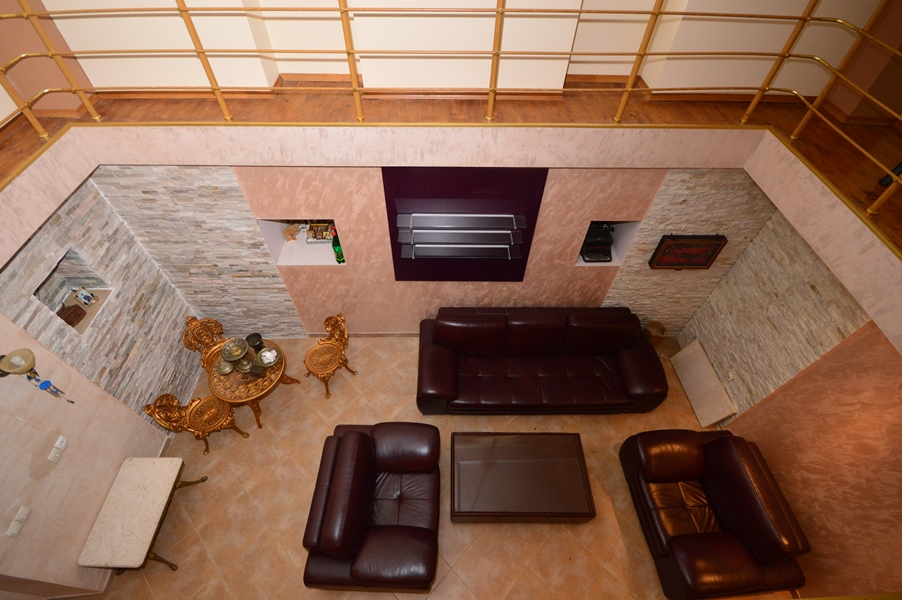 rn2377-beautiful-natural-stone-villa-living-room-above
